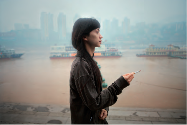 Tomoko Kikuchi -Hua standing by the Yantze river, Chongqing, 2008